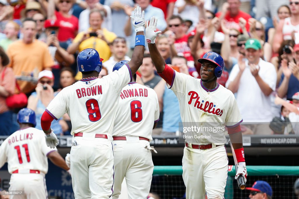 Domonic Brown #9 of the Philadelphia Phillies is congratulated by John Mayberry Jr. #15 after hitting a three run home run in the first inning of the game against the Milwaukee Brewers at Citizens Bank Park on June 2, 2013 in Philadelphia, Pennsylvania.