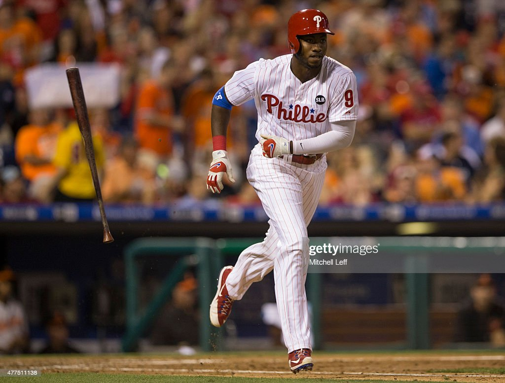 Domonic Brown #9 of the Philadelphia Phillies throws his bat after a fly out in bottom of the seventh innning against the Baltimore Orioles on June 17, 2015 at the Citizens Bank Park in Philadelphia, Pennsylvania. The Orioles defeated the Phillies 6-4.