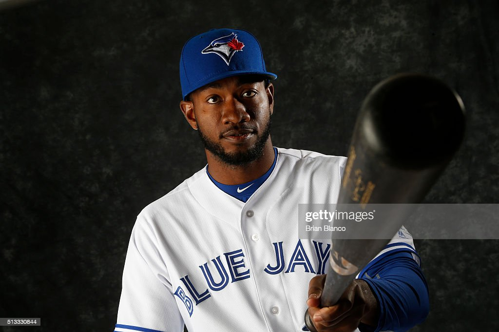 Domonic Brown #81 of the Toronto Blue Jays poses for a photo during the Blue Jays' photo day on February 27, 2016 in Dunedin, Florida.