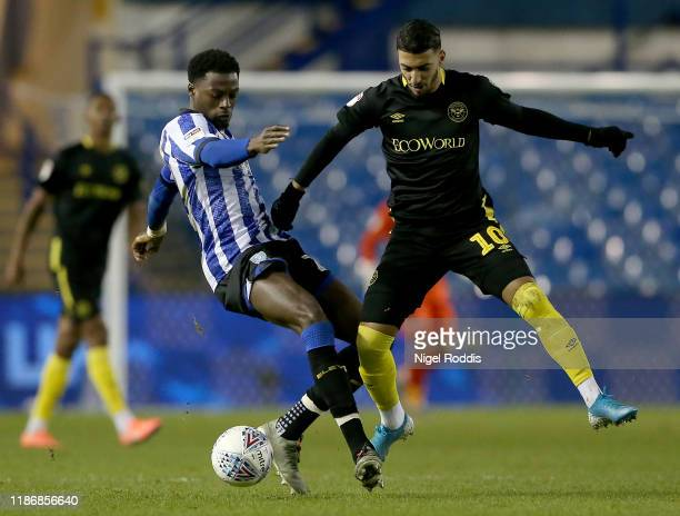 Domonic Iorfa of Sheffield Wednesday challenges Said Benrahma of Brentford during the Sky Bet Championship match between Sheffield Wednesday and...