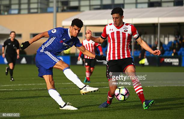 Domonic Solanke of Chelsea shoots on goal as Alfie Jones of Southampton blocks during the Premier League 2 match between Chelsea and Southampton at...