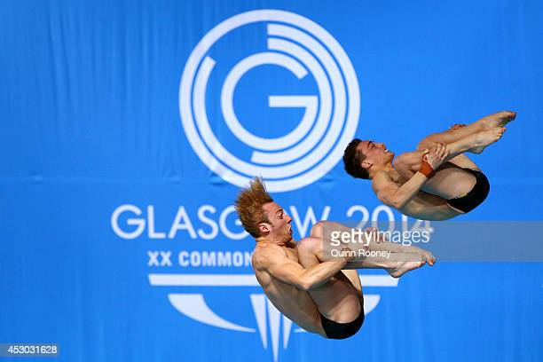 Domonoic Bedggood and Matthew Mitcham of Australia compete in the Men's Synchronised 10m Platform Final at Royal Commonwealth Pool during day nine of...