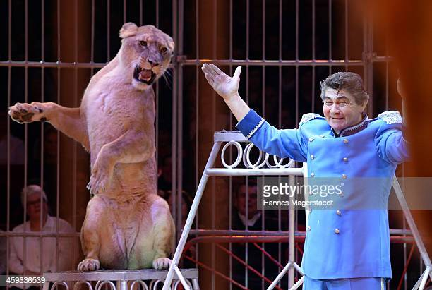 Domteur Kid Bauer perfoms with his lions during the Circus Krone Christmas Show at Circus Krone on December 25 2013 in Munich Germany