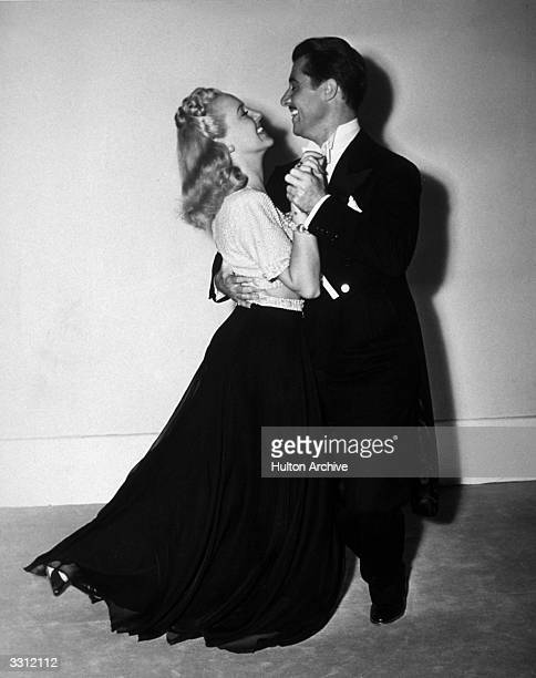 Don Ameche and Betty Grable dance the rhumba in the film 'Down Argentine Way', directed by Irving Cummings for 20th Century Fox.