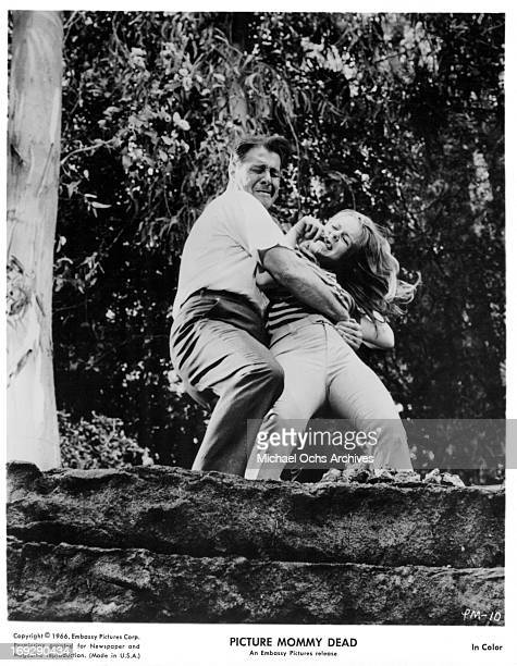 Don Ameche grabs Susan Gordon in a scene from the film 'Picture Mommy Dead' 1966