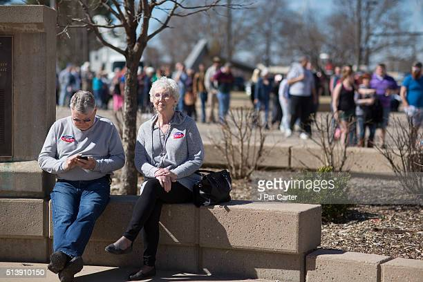 Don and Jo Payne take a rest as they wait in line to vote during the state's Republican caucus on March 5 2016 in Wichita Kansas People were standing...