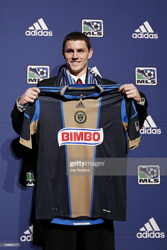 Don Anding of Northeastern University poses for photos after being selected by Philadelphia Union as the 26th overall pick in the 2013 MLS SuperDraft Presented by Adidas at the Indiana Convention Center on January 17, 2013 in Indianapolis, Indiana.