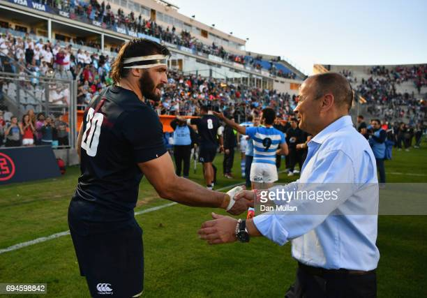 Don Armand of England shakes hands with Eddie Jones head coach of England after the International Test match between Argentina and England at Estadio...