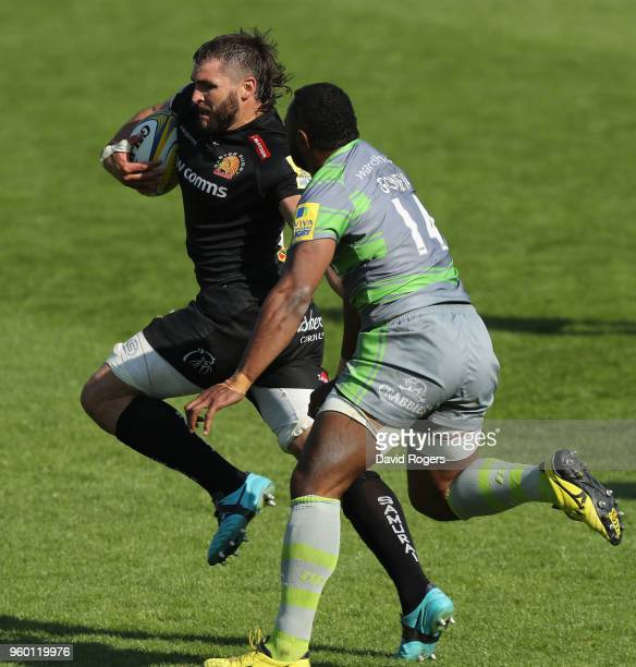 Don Armand of Exeter breaks away from Vereniki Goneva to score their final try during the Aviva Premiership Semi Final between Exeter Chiefs and...