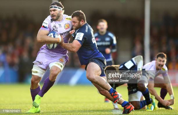 Don Armand of Exeter Chiefs is held by Akker Van Der Merwe of Sale Sharks during the Heineken Champions Cup Round 4 match between Exeter Chiefs and...