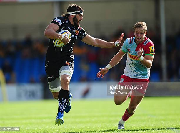 Don Armand of Exeter Chiefs is tackled by Charlie Walker of Harlequins during the Aviva Premiership match between Exeter Chiefs and Harlequins at...