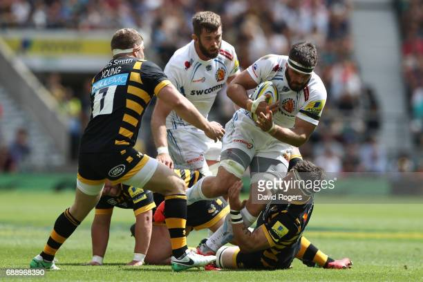 Don Armand of Exeter Chiefs is tackled by Guy Thompson and Thomas Young of Wasps during the Aviva Premiership Final between Wasps and Exeter Chiefs...
