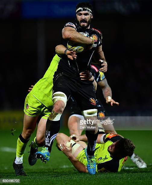 Don Armand of Exeter Chiefs is tackled by Jono Kitto of Leicester Tigers and Ed Slater of Leicester Tigers during the Aviva Premiership match between...
