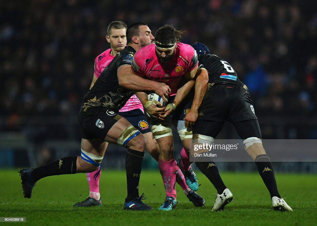 Don Armand of Exeter Chiefs is tackled by Louis Picamoles and Julien Bardy of Montpellier during the European Rugby Champions Cup match between Exeter Chiefs and Montpellier at Sandy Park on January 13, 2018 in Exeter, England.