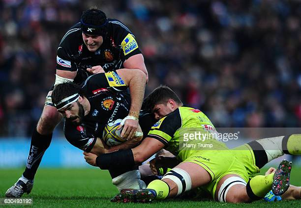 Don Armand of Exeter Chiefs is tackled by Mike Williams of Leicester Tigers during the Aviva Premiership match between Exeter Chiefs and Leicester...