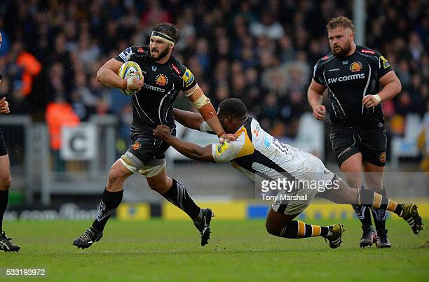 Don Armand of Exeter Chiefs is tackled by Simon McIntyre of Wasps during the Aviva Premiership semi final match between Exeter Chiefs and Wasps at...
