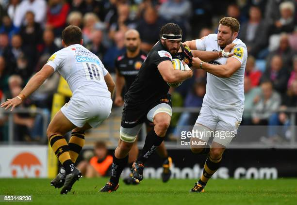 Don Armand of Exeter Chiefs is tackled by Thomas Young of Wasps during the Aviva Premiership match between Exeter Chiefs and Wasps at Sandy Park on...