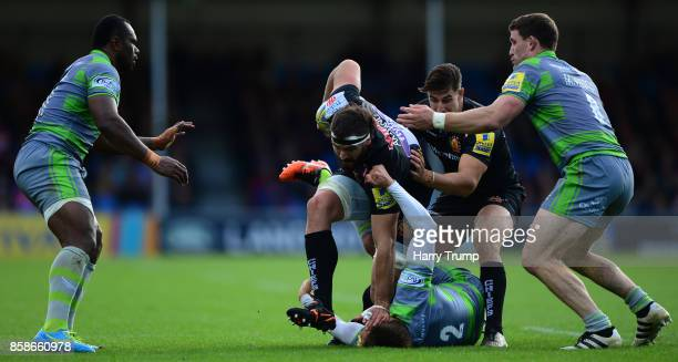 Don Armand of Exeter Chiefs is tackled by Toby Flood of Newcastle Falcons during the Aviva Premiership match between Exeter Chiefs and Newcastle...