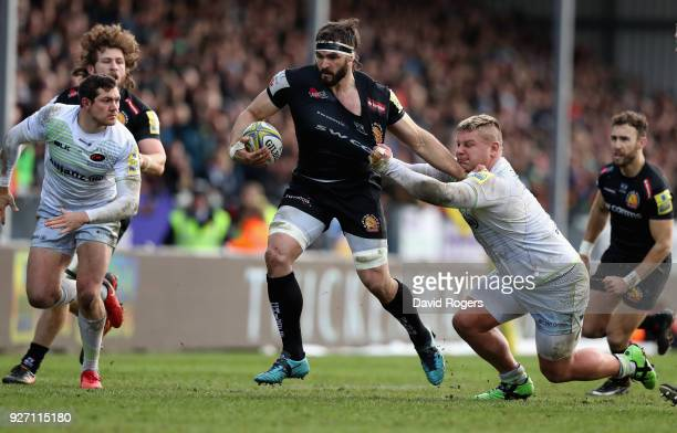 Don Armand of Exeter is held by Richard Barringnton during the Aviva Premiership match between Exeter Chiefs and Saracens at Sandy Park on March 4...