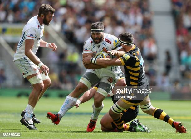 Don Armand of Exeter is tackled by Guy Thompson during the Aviva Premiership match between Wasps and Exeter Chiefs at Twickenham Stadium on May 27...