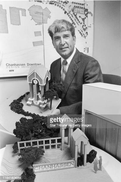 Don Ashworth, city manager for Chanhassen MN at time of this photo, is shown with models of a clock tower and other buildings, maps, etc., part of...