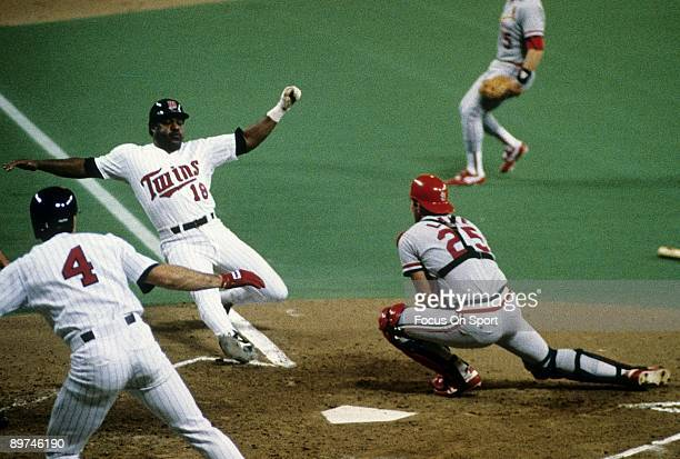 Don Baylor of the Minnesota Twins sliding into homeplate trying to beat the tag of Catcher Steve Lake of the St Louis Cardinals in a world series...