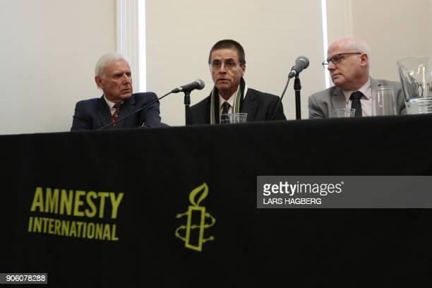 Don Bayne Hassan Diab and Alex Neve Secretary General of Amnesty International Canada hold a press conference at Amensty International Canada in...