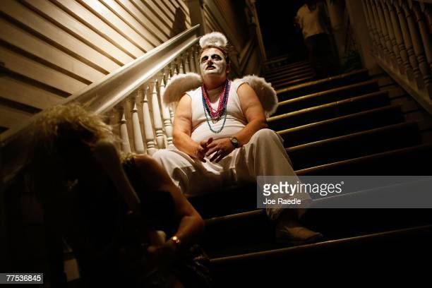 Don Bellucci sits on steps while attending the Fantasy Fest parade October 27 2007 in Key West Florida The ten day costuming and masking festival...