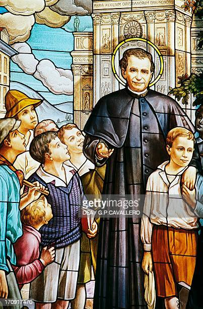 Don Bosco and children stained glass window Colle Don Bosco Sanctuary Castelnuovo Don Bosco Piedmont Italy