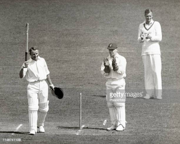 Don Bradman of Australia acknowledges the cheers of the crowd after completing his double-century during the decisive final Test match between...