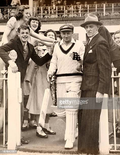 Don Bradman walking out to bat in his Testimonial match at the Melbourne Cricket Ground in Australia 4th December 1948 More than 90000 spectators...