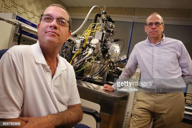 Don Burl III left and Dr John A Notte pose for a portrait with an Orion NanFab a helium ion microscope at Carl Ziess Micoscopy in Peabody MA on Oct 3...