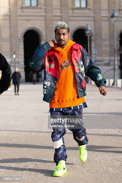 Don C is seen on the street during Paris Men's Fashion Week wearing orange hoodie OffWhite pants and neon green Nikes on January 16 2019 in Paris...