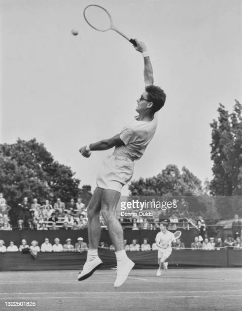 Don Candy of Australia jumps to make an overhead smash forehand return to Staffan Stockenberg during their Men's Singles match at the Kent Tennis...