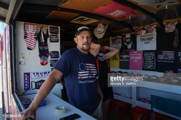 Don Caple poses in his roadside Trump-themed trailer near the Cadillac Ranch art installation in Amarillo, Texas, on July 31, 2020. - Don is a...
