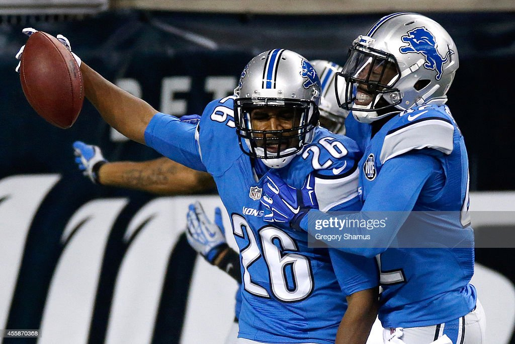 Don Carey #26 of the Detroit Lions celebrates a first quarter fumble return touchdown against the Green Bay Packers at Ford Field on September 21, 2014 in Detroit, Michigan.