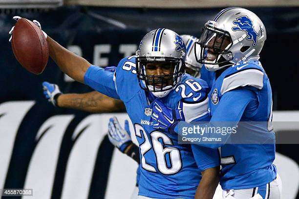 Don Carey of the Detroit Lions celebrates a first quarter fumble return touchdown against the Green Bay Packers at Ford Field on September 21 2014 in...
