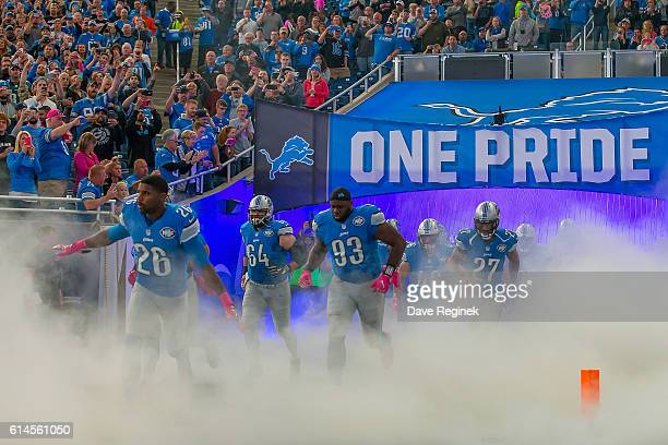 Don Carey, Travis Swanson, Tyrunn Walker and Glover Quin of the Detroit Lions head out to the field before an NFL game against the Philadelphia...