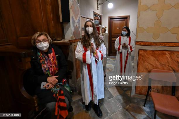 Don Carlo Chiomento Parish priest of the Community of Candiolo during the celebration of the Christmas Mass on December 24, 2020 in Turin, Italy. Due...