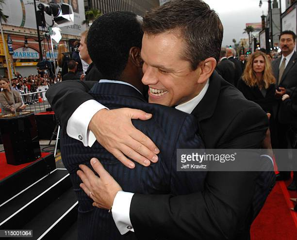 Don Cheadle and Matt Damon during 'Ocean's Thirteen' Los Angeles Premiere Red Carpet at Grauman's Chinese Theater in Hollywood California United...