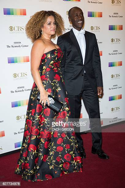 Don Cheadle poses on the red carpet with his wife Bridgid Latrice Coulter before the 39th Annual Kennedy Center Honors December 4 2019 in Washington...