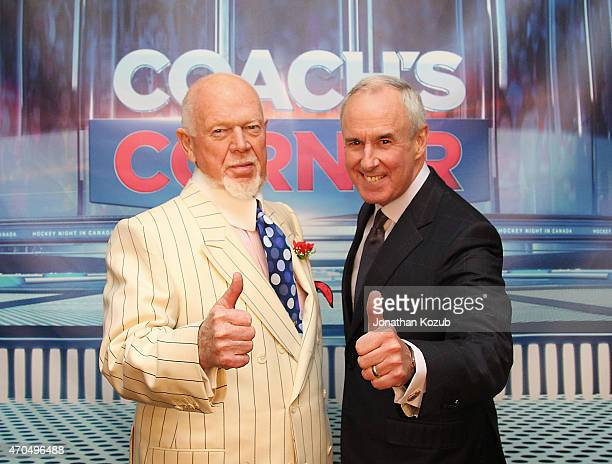 Don Cherry and Ron MacLean of Hockey Night In Canada pose for a photo following an overtime game between the Winnipeg Jets and the Anaheim Ducks in...