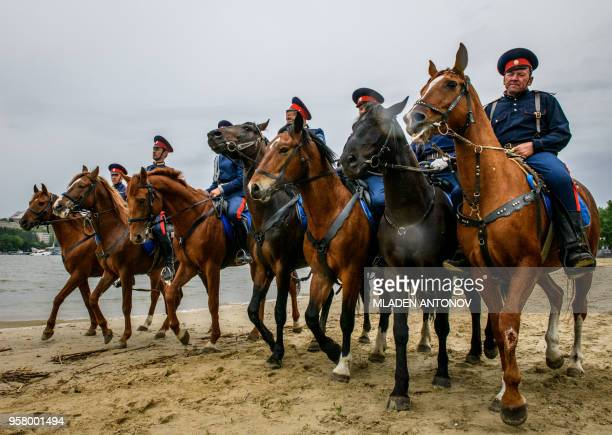 Don Cossacks practise their riding skills on the left bank of Don river outside Rostov Arena in the southern Russian city of RostovonDon on May 13...
