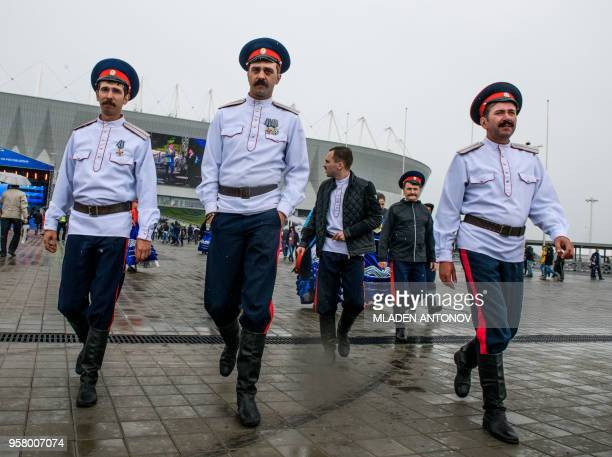 Don Cossacks walk outside Rostov Arena in the southern Russian city of RostovonDon on May 13 2018 The Rostov Arena will host five football matches of...