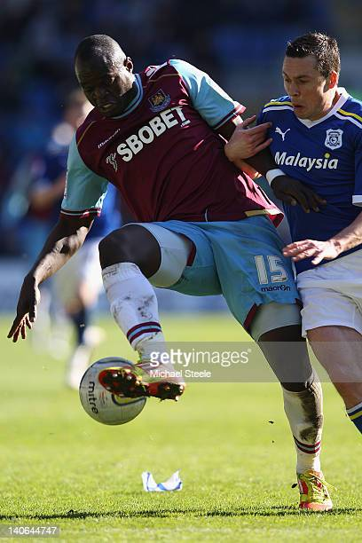 Don Cowie of Cardiff City challenges Abdoulaye Faye of West Ham United during the npower Championship match between Cardiff City and West Ham United...