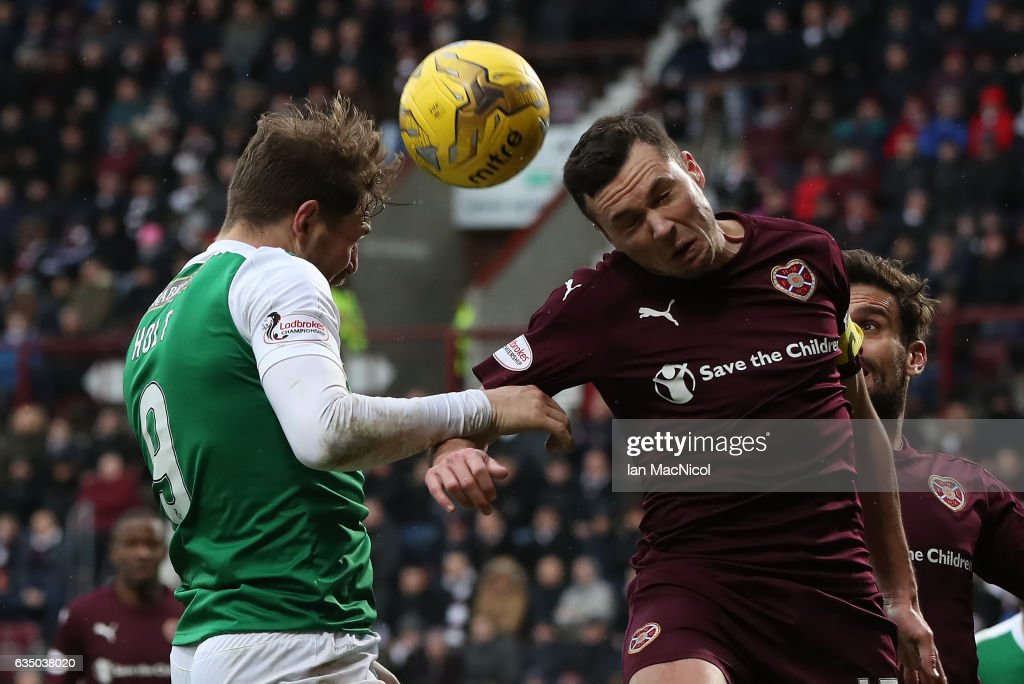 Don Cowie of Heart of Midlothian vies with Grant Holt of Hibernian during the Scottish Cup Fifth Round match between Heart of Midlothian and Hibernian at Tynecastle Stadium on February 12, 2017 in Edinburgh, Scotland.