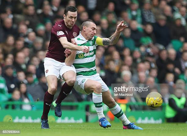 Don Cowie of Hearts and Scott Brown of Celtic battle for possession during the Ladbrokes Scottish Premiership match between Celtic and Heart of...