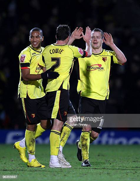 Don Cowie of Watford is congratulated by Heidar Helguson after he scoring their team's third goal during the CocaCola Championship match between...