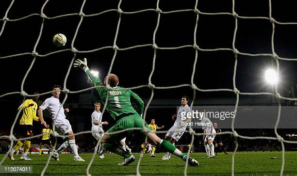 Don Cowie of Watford scores their second goal past goalkeeper John Ruddy of Norwich City during the npower Championship match between Watford and...