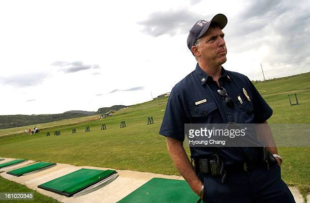Don <cq> Lombadi <cq>, Asst. Chief of West Metro Fire Department, is in the driving range of the Meadows Golf Club on Saturday afternoon. Five people...